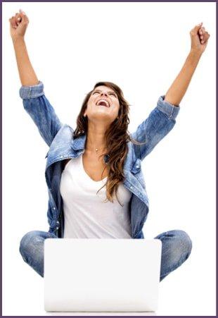 Woman holding hands up after winning online scavenger hunt