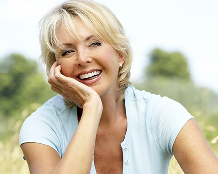 A mature woman with a perfect smile to show that Smile Design is offered as part of our cosmetic dentistry in Wichita KS
