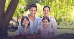 Welcome to Our Blog! Family smiling outdoors
