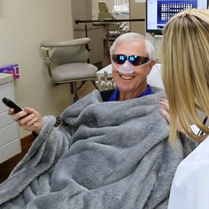 Man being pampered with a blanket and N2O laughing gas with our dentist Wichita KS