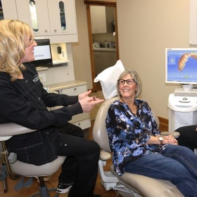 A female patient talking to a team member about xylimelts
