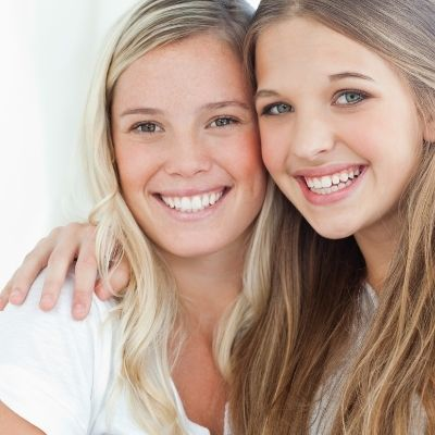 Two female patients who protect their teeth with fluoride varnish
